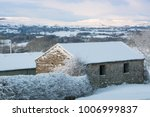 Snow Covered Barn With...