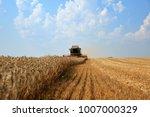 combine harvester working on a...   Shutterstock . vector #1007000329