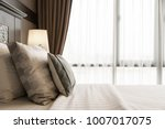 comfort pillow on bed with... | Shutterstock . vector #1007017075