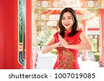 smiling asian woman in... | Shutterstock . vector #1007019085