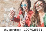 happy fashion friends watching... | Shutterstock . vector #1007025991
