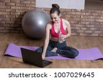 a young woman sports blogger is ... | Shutterstock . vector #1007029645