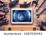 tablet pc with security concept ... | Shutterstock . vector #1007033491
