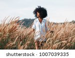 cheerful african american young ... | Shutterstock . vector #1007039335