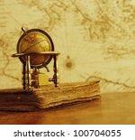 globe and vintage book against...