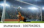 soccer goalkeeper in action on... | Shutterstock . vector #1007042821
