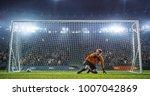 soccer goalkeeper in action on... | Shutterstock . vector #1007042869