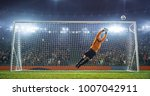 soccer goalkeeper in action on... | Shutterstock . vector #1007042911