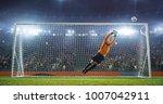 soccer goalkeeper in action on... | Shutterstock . vector #1007042911