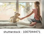 little girl with teddy bear... | Shutterstock . vector #1007044471