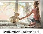 little girl with teddy bear... | Shutterstock . vector #1007044471