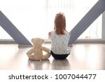 little girl with teddy bear... | Shutterstock . vector #1007044477