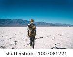 back view of female traveler...   Shutterstock . vector #1007081221