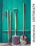 old garden tools over wooden... | Shutterstock . vector #1007081674