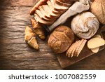fresh baked bread on rustic... | Shutterstock . vector #1007082559