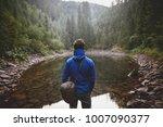 Young Hiker Wearing Blue Jacke...