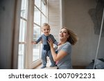 mom and son with blond hair... | Shutterstock . vector #1007092231