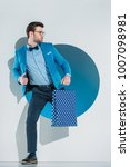 handsome stylish young man with ... | Shutterstock . vector #1007098981