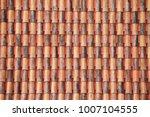 tiles of old roof in... | Shutterstock . vector #1007104555