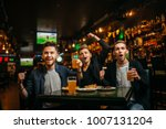 men at the table with beer ... | Shutterstock . vector #1007131204