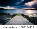 stormy skies along the coast ... | Shutterstock . vector #1007134411