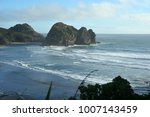piha beach with rock formations ... | Shutterstock . vector #1007143459