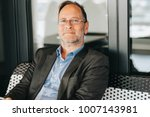 outdoor portrait of 50 year old ... | Shutterstock . vector #1007143981