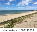 panoramic view of beach with... | Shutterstock . vector #1007145259