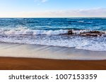 picturesque waves wash the... | Shutterstock . vector #1007153359