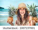 beautiful girl with pineapple... | Shutterstock . vector #1007157001