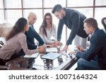 young team of coworkers making... | Shutterstock . vector #1007164324