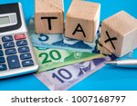 wooden cubes tax with canadian... | Shutterstock . vector #1007168797