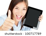 Tablet computer woman happy excited showing touch pad screen and thumbs up. Beautiful winning mixed race Asian Chinese / Caucasian female model. - stock photo