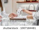 closeup of female client... | Shutterstock . vector #1007184481