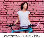 young beautiful girl stands... | Shutterstock . vector #1007191459