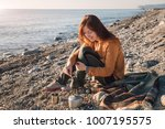 young woman cooking coffee on... | Shutterstock . vector #1007195575