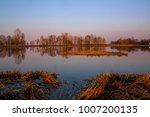 beautiful sunset on the lake | Shutterstock . vector #1007200135