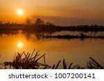 beautiful sunset on the lake | Shutterstock . vector #1007200141