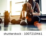 sport woman sitting and resting ... | Shutterstock . vector #1007210461