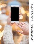 beautiful female hands holding...   Shutterstock . vector #1007212441