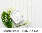 cosmetic cream and lily of the... | Shutterstock . vector #1007215165