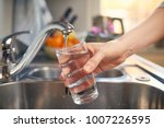 pouring fresh tap water into a... | Shutterstock . vector #1007226595