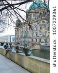 Small photo of Berlin, Germany - December 30, 2017: Downtown Berlin on a winter day. Berlin Cathedral or Berliner Dom. The capital of the Germany is decorated with New Year's illumination.