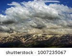 snowy mountain and clouds. | Shutterstock . vector #1007235067