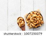 cashew nuts put on cups and... | Shutterstock . vector #1007250379