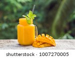 mango smoothie in a glass mason ... | Shutterstock . vector #1007270005