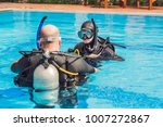 diving instructor and students. ... | Shutterstock . vector #1007272867