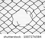 steel mesh fence with torn hall ... | Shutterstock . vector #1007276584