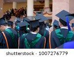 graduates wear graduation gowns ... | Shutterstock . vector #1007276779