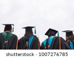 graduates wear graduation gowns ... | Shutterstock . vector #1007276785